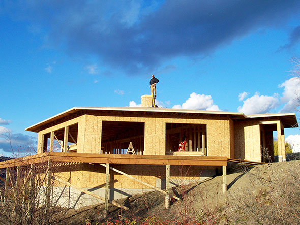 A wrap around deck offers spectacular valley views.